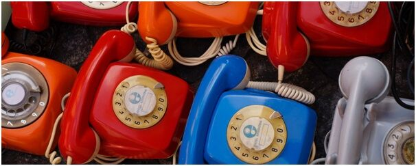 Row of telephones illustrating communication with interviewer