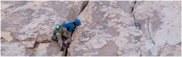 Climber crossing dangerous rocks, demonstrating risks of making common mistakes in indentifying the problem in case studies