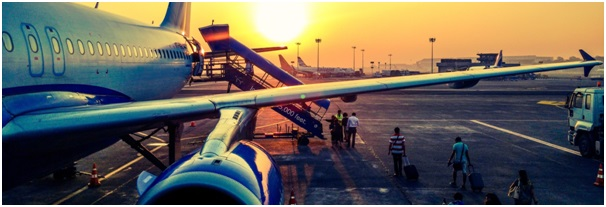 Travellers boarding a plane, illustrating our example case study on the profitability of a travel agent