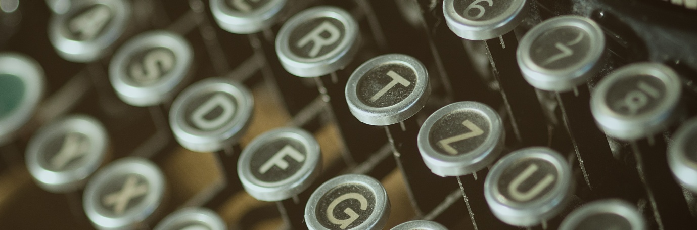 Typewriter keys, illustrating the process of writing up a consulting resume