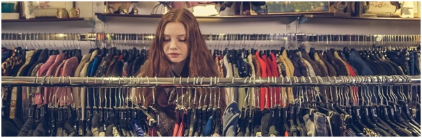 Young woman browsing clothing, illustrating a PST worked example question on a clothing retailer