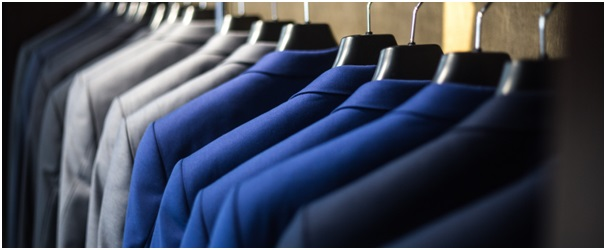 Rail of suits in shades of blue and grey
