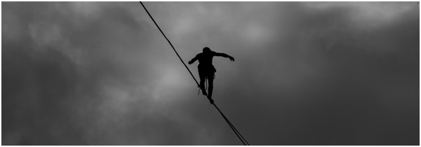 Tightrope walker on a highwire viewed from below